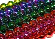 Magic beads with a metallic coating